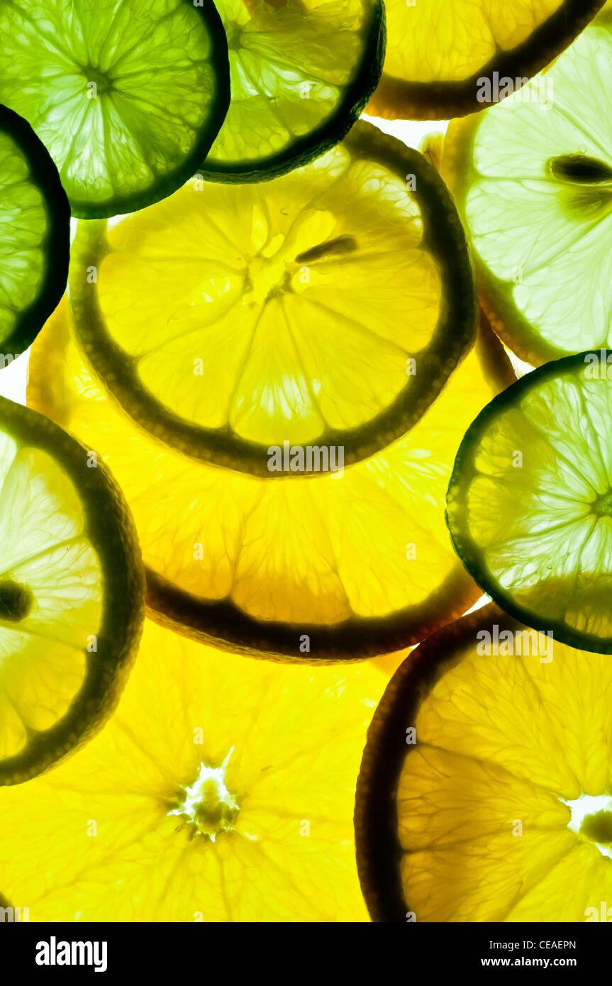 Scheiben von Orangen, Zitronen und Limetten Stockbild