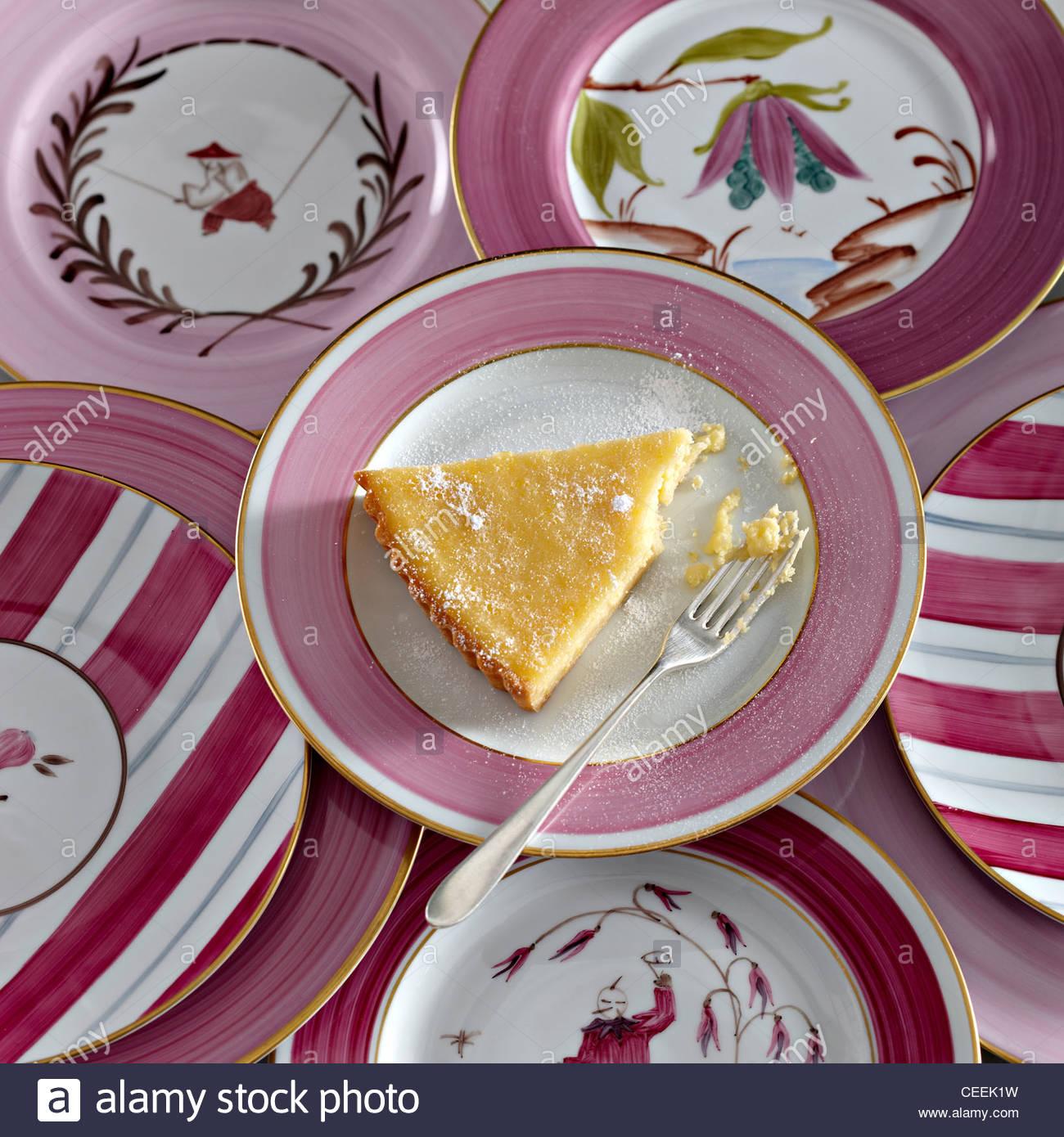 Zitronen Torte rosa umrandeten Teller Gabel Stockbild