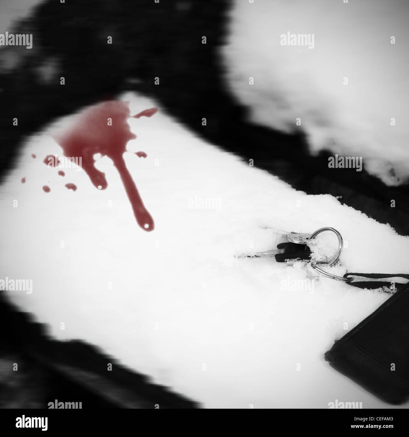 Schlüsselbund auf einer Bank mit Schnee mit Blut Tropfen Stockbild