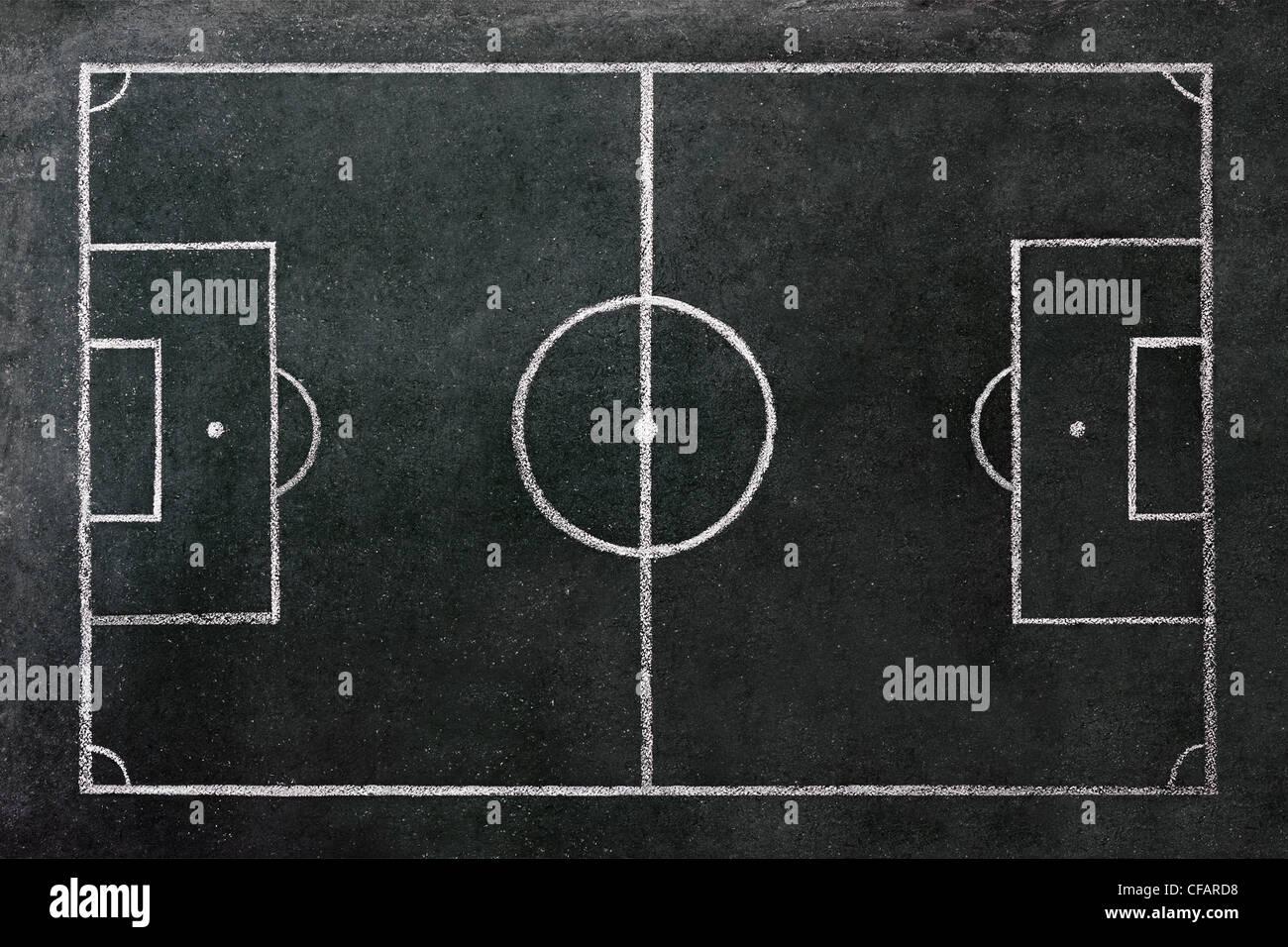 Fußballplatz auf einer Tafel gezeichnet. Stockbild