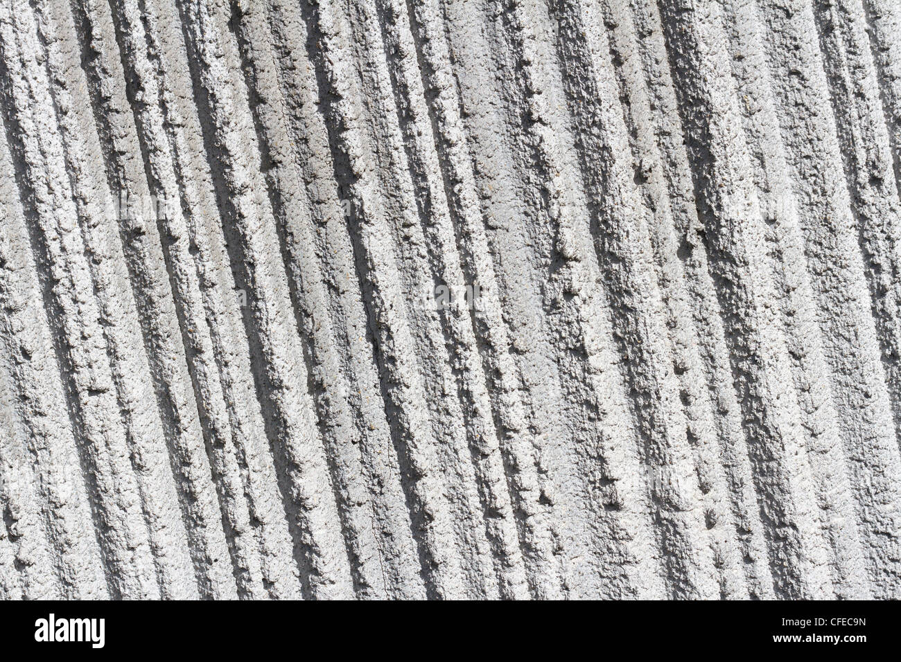 Graue Betonwand für strukturierte Hintergründe Stockbild