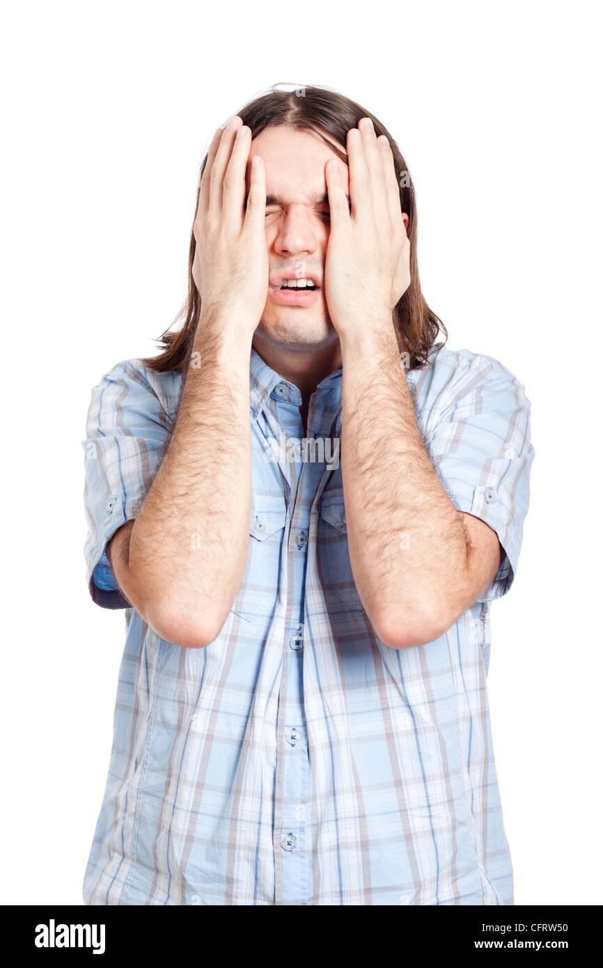 Junger Mann leiden, isolierten auf weißen Hintergrund. Stockbild