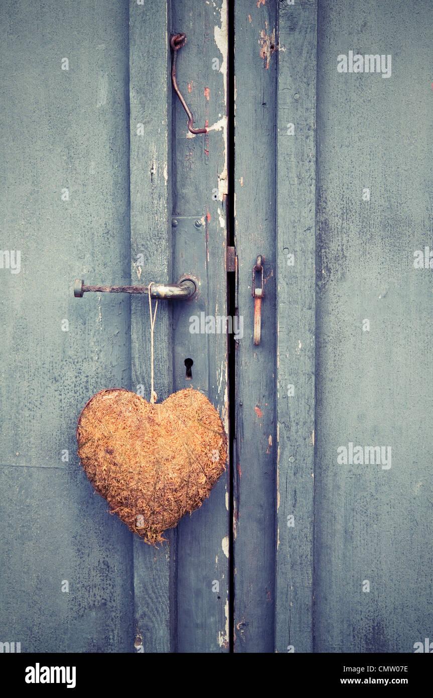 Nahaufnahme der Tür mit einem Herzen Stockbild