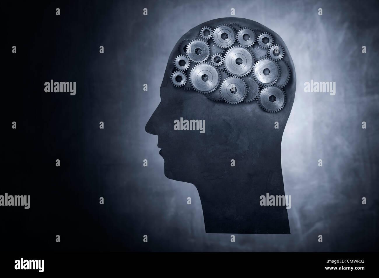 Konzeptbild von Kopf gefüllt mit Zahnrad-Getriebe. Stockfoto