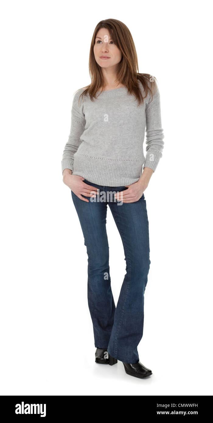 Voller Länge Foto attraktive 30-jährige Frau stehend, isoliert auf weißem Hintergrund. Stockbild