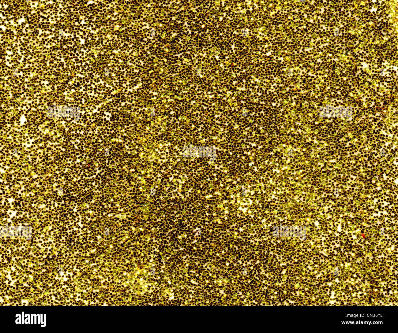 Goldglitter Makro Nahaufnahme Textur Hintergrund. Stockbild