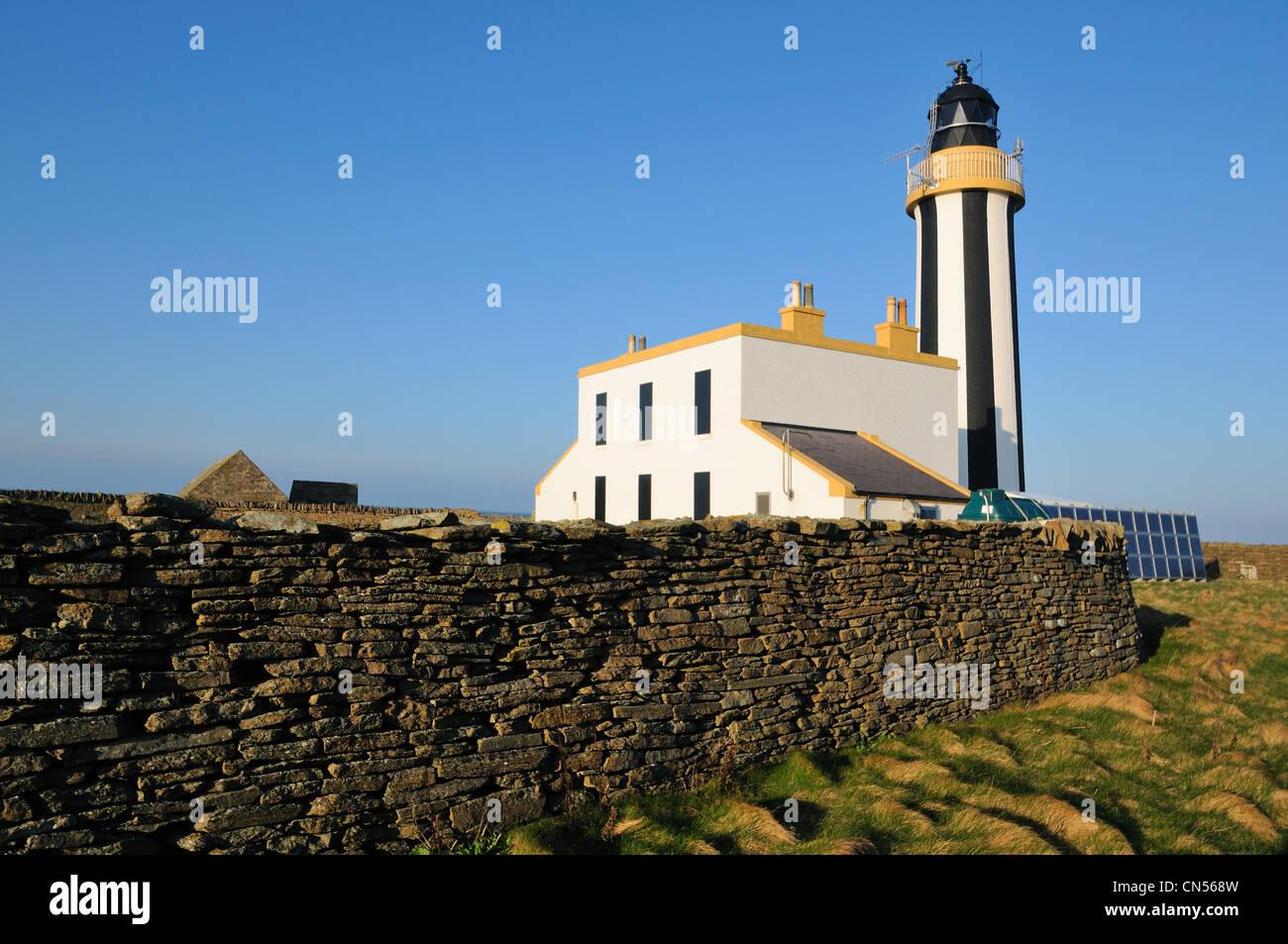 Start Point Leuchtturm bei Sonnenuntergang, Sanday, Orkney Stockfoto