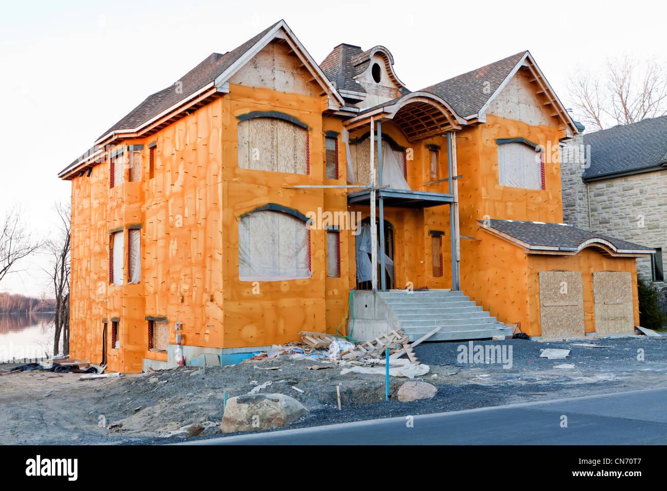 Bau-Schaum gedämmten Haus Stockbild