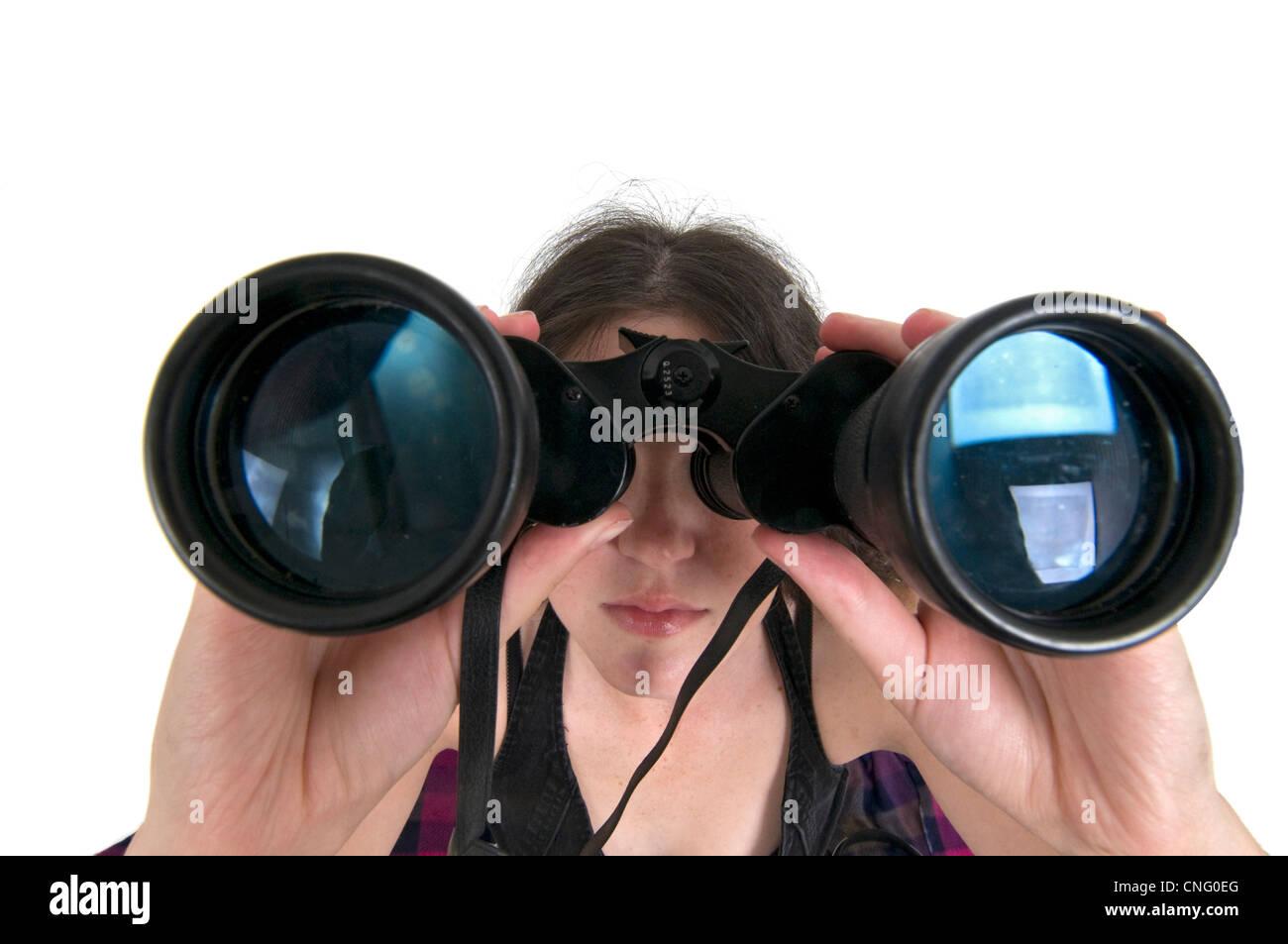 Frau mit dem Fernglas Stockbild