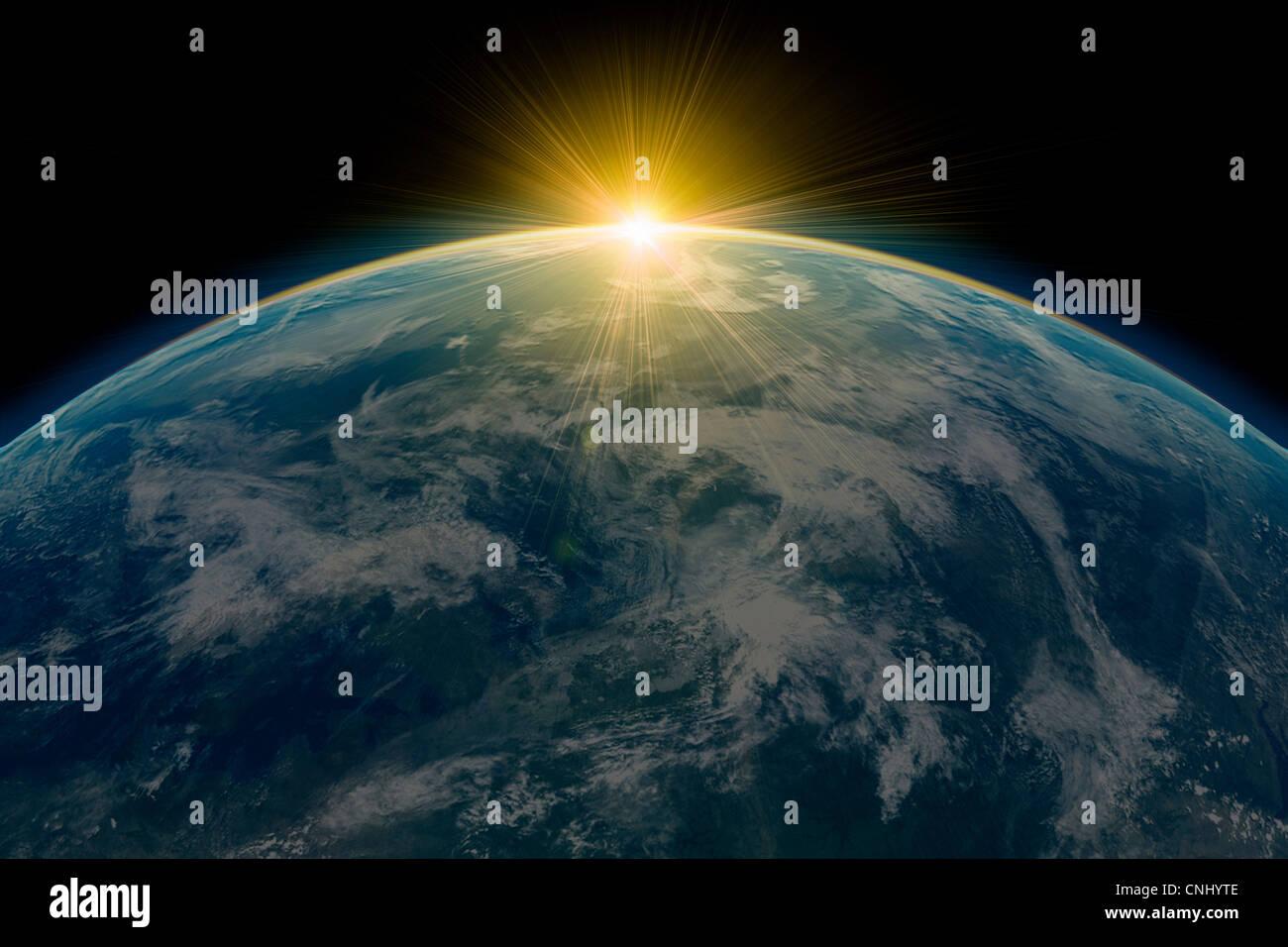 Sonnenaufgang über dem Planetenerde Stockbild