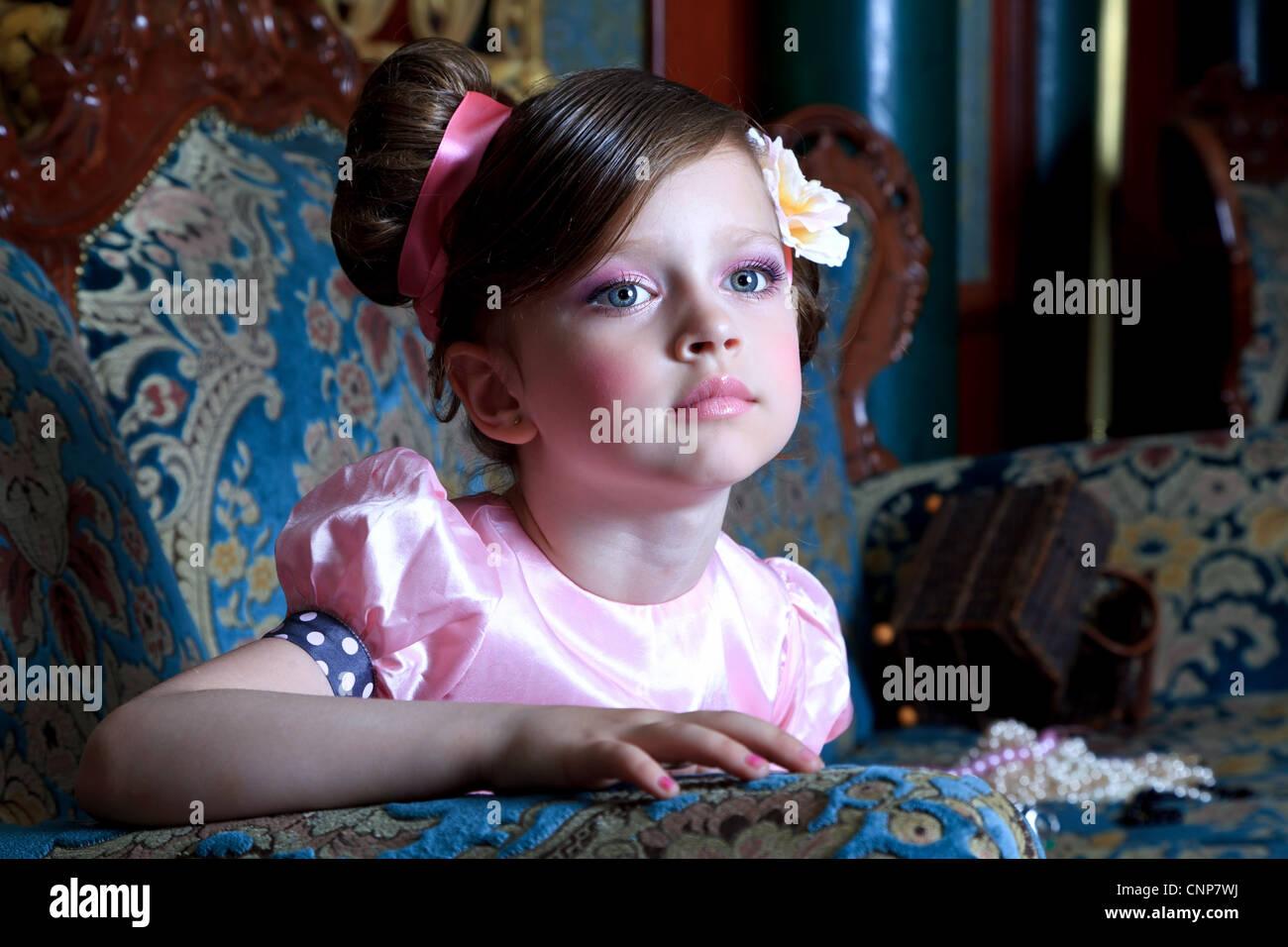 Mädchen in rosa Stockbild