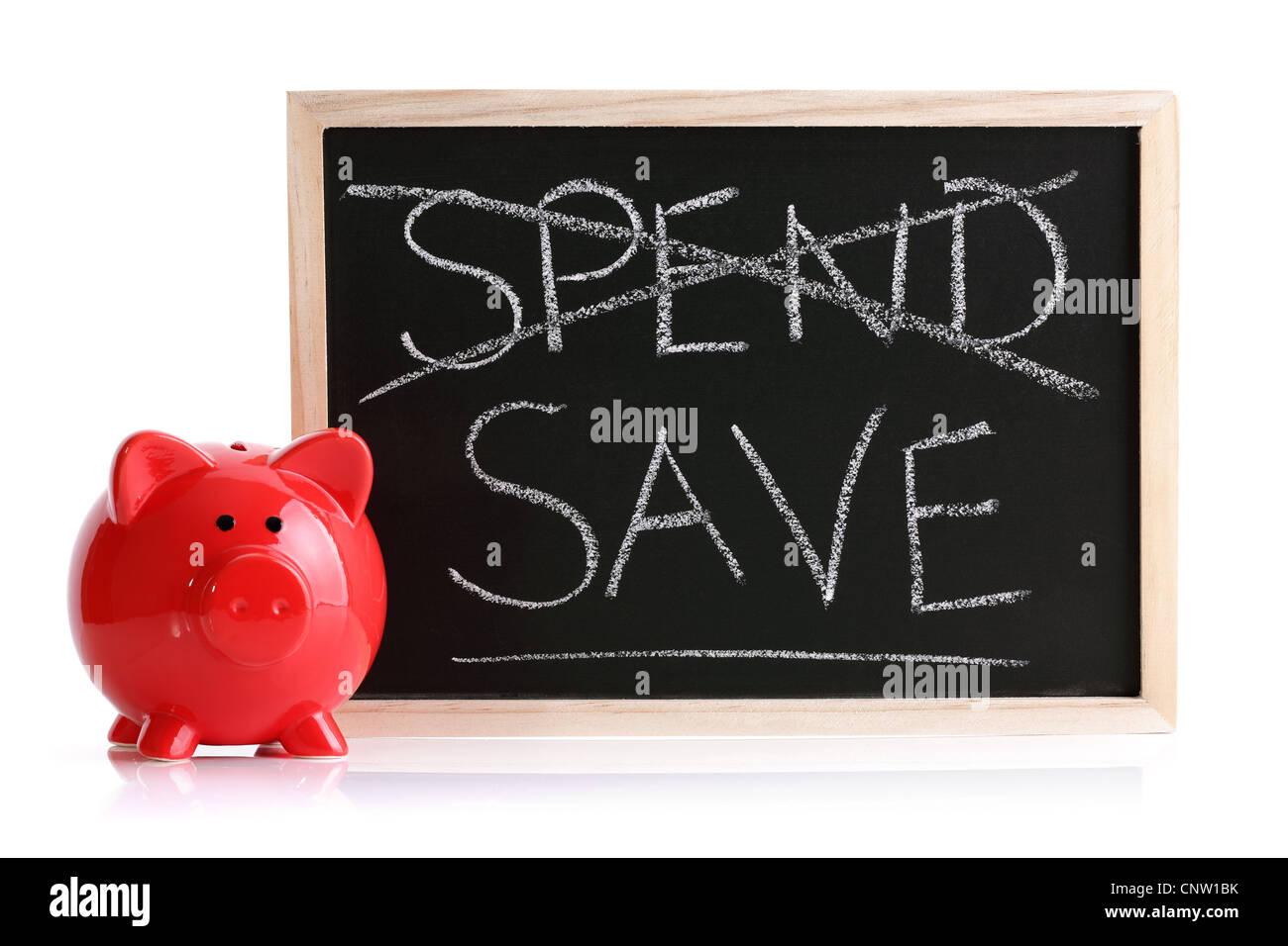 Piggy Bank ausgeben oder sparen Stockbild