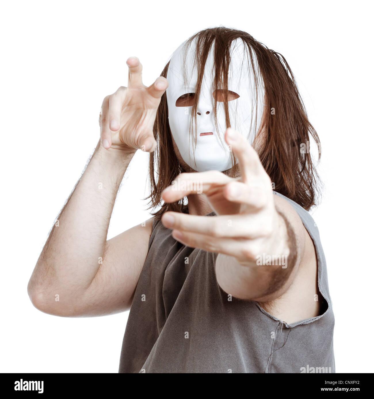 Wahnsinnige unheimlich maskierte gestikulieren, isoliert auf weißem Hintergrund. Stockbild