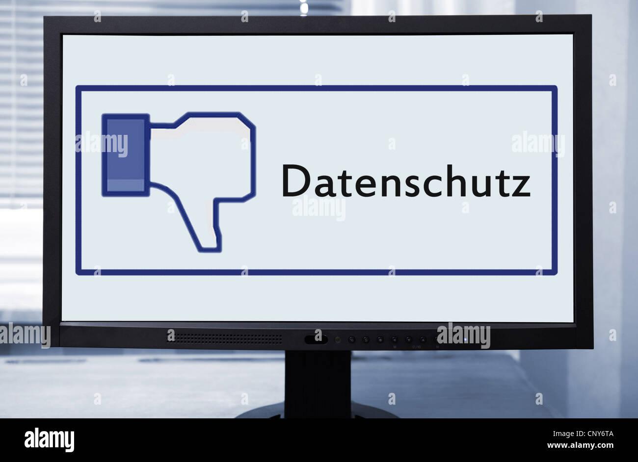 """Facebook-Symbol """"Thumb up"""" im Zusammenhang mit dem Begriff """"Datenschutz"""" symbolisiert die Plattform Stockbild"""