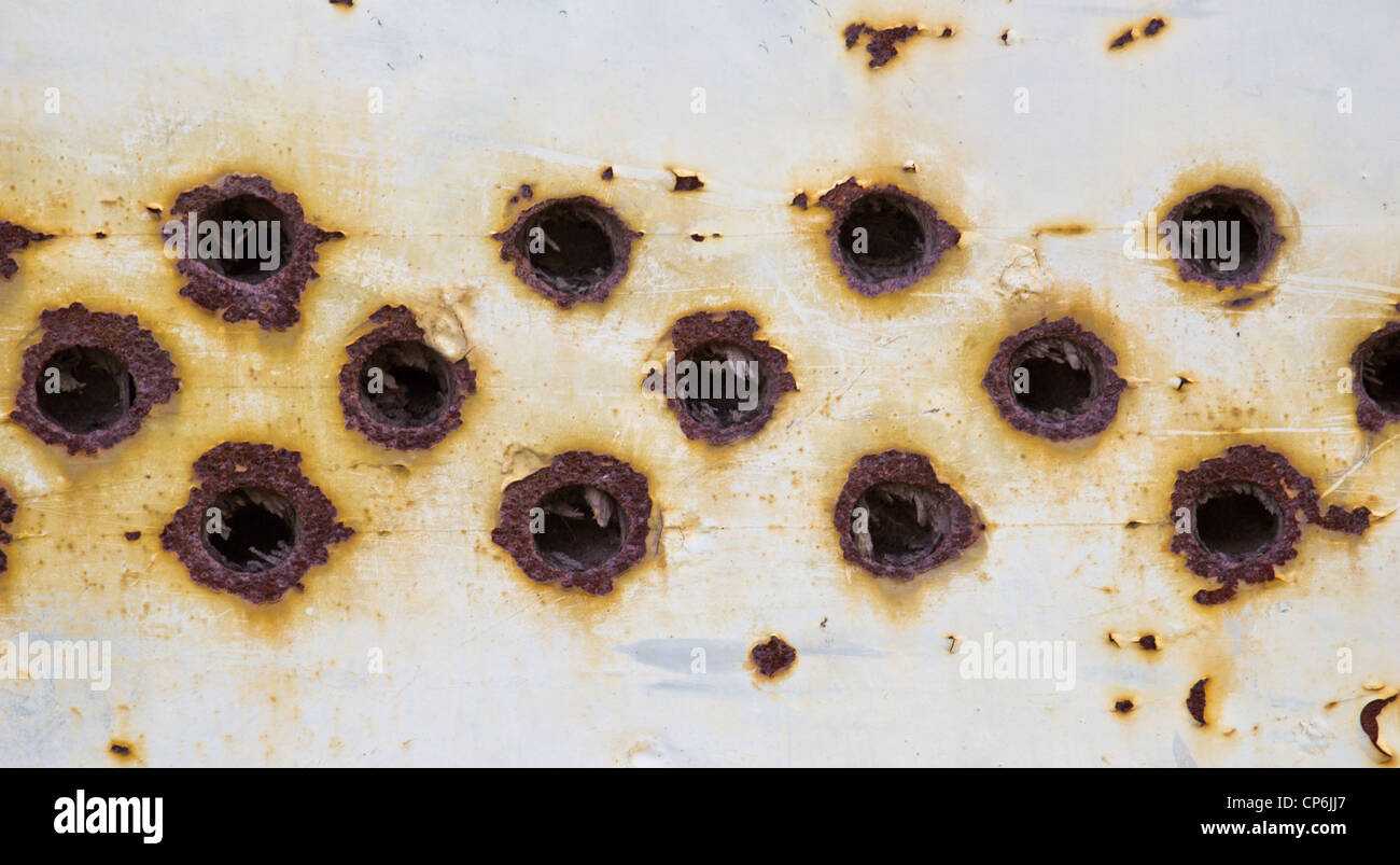 rust holes stockfotos rust holes bilder alamy. Black Bedroom Furniture Sets. Home Design Ideas