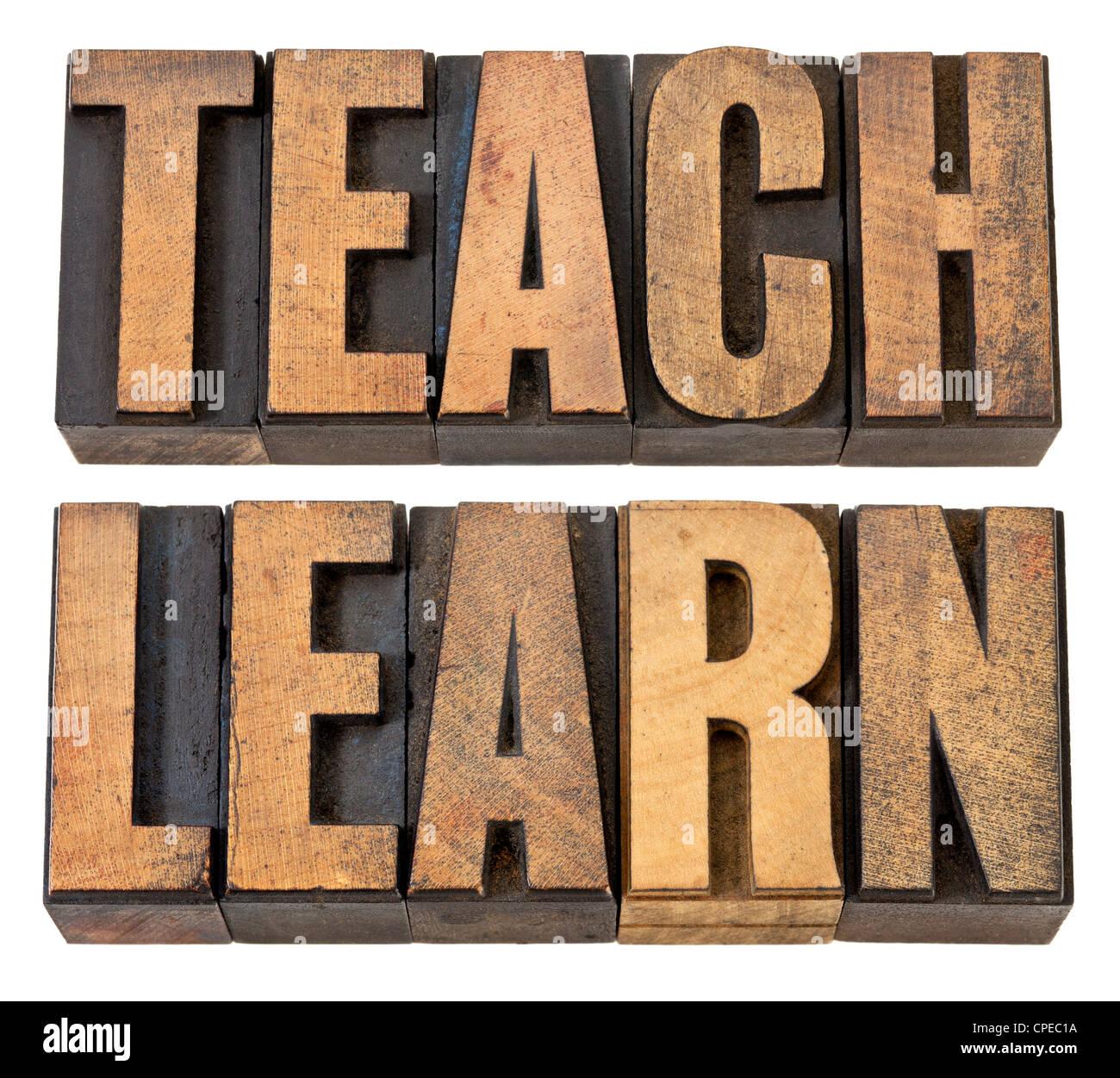 Lehren Sie und lernen Sie-Bildungskonzept - isolierte Wörter in Vintage Buchdruck Holzart Stockbild