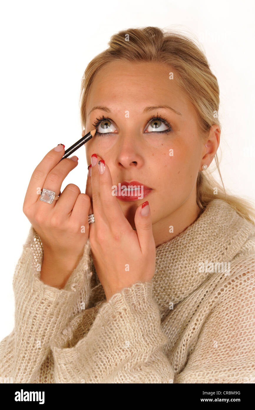 Junge Frau Schminken, eyeliner Stockbild