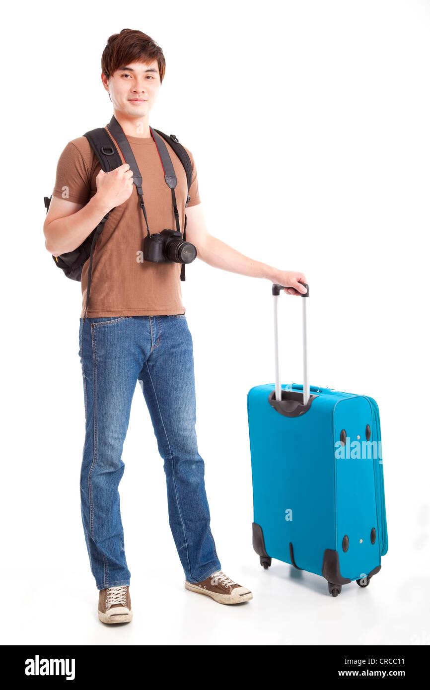 volle Länge des jungen Reisenden mit Koffer Stockbild