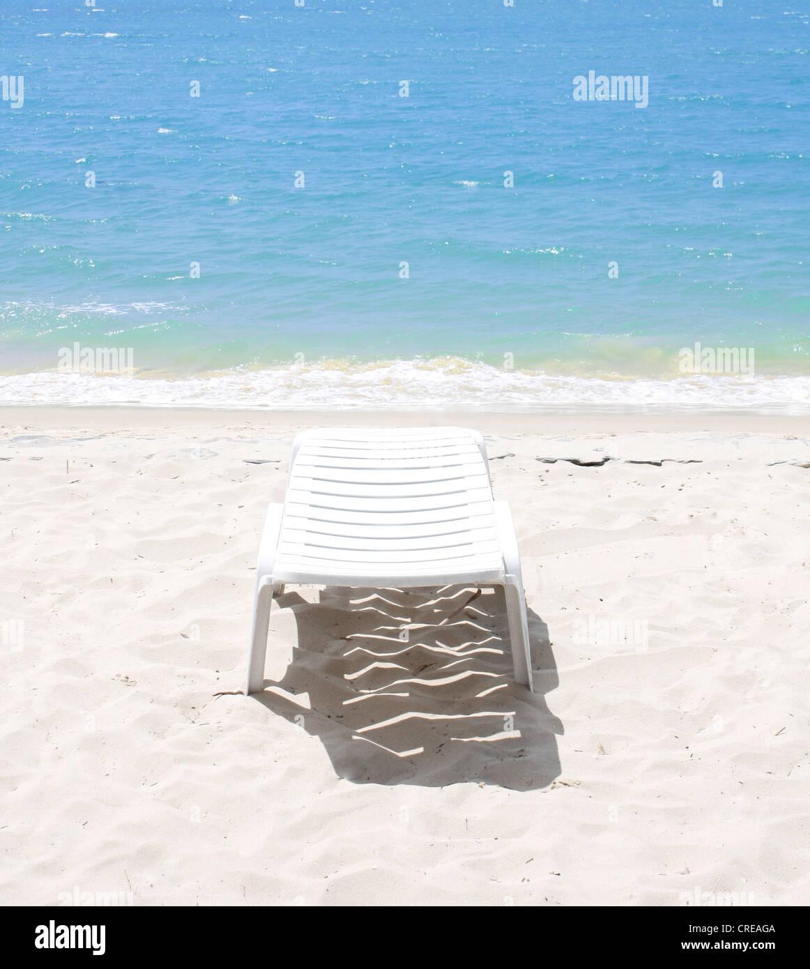 Stuhl am Strand Stockbild