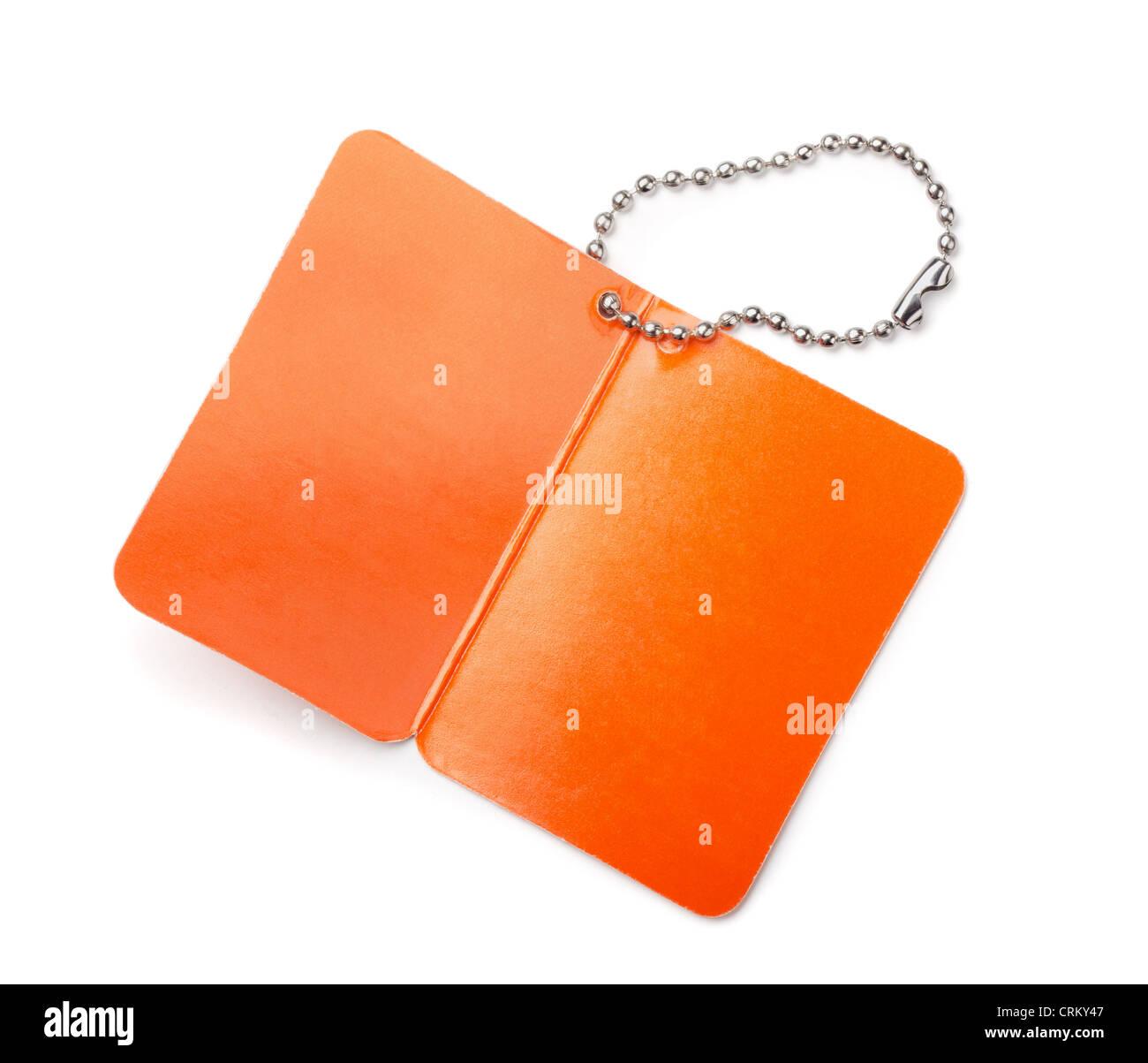 Orange Blankopapier Tag isoliert auf weiss Stockbild