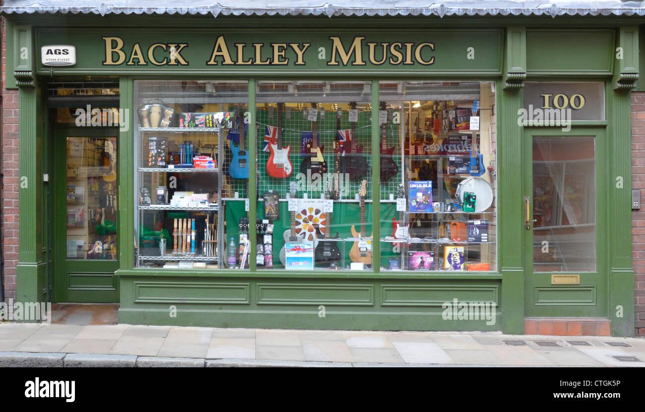 'Back Alley Music' shop Frontscheibe Fachhändler für Musikinstrumente in Northgate Street Stadt Stockbild