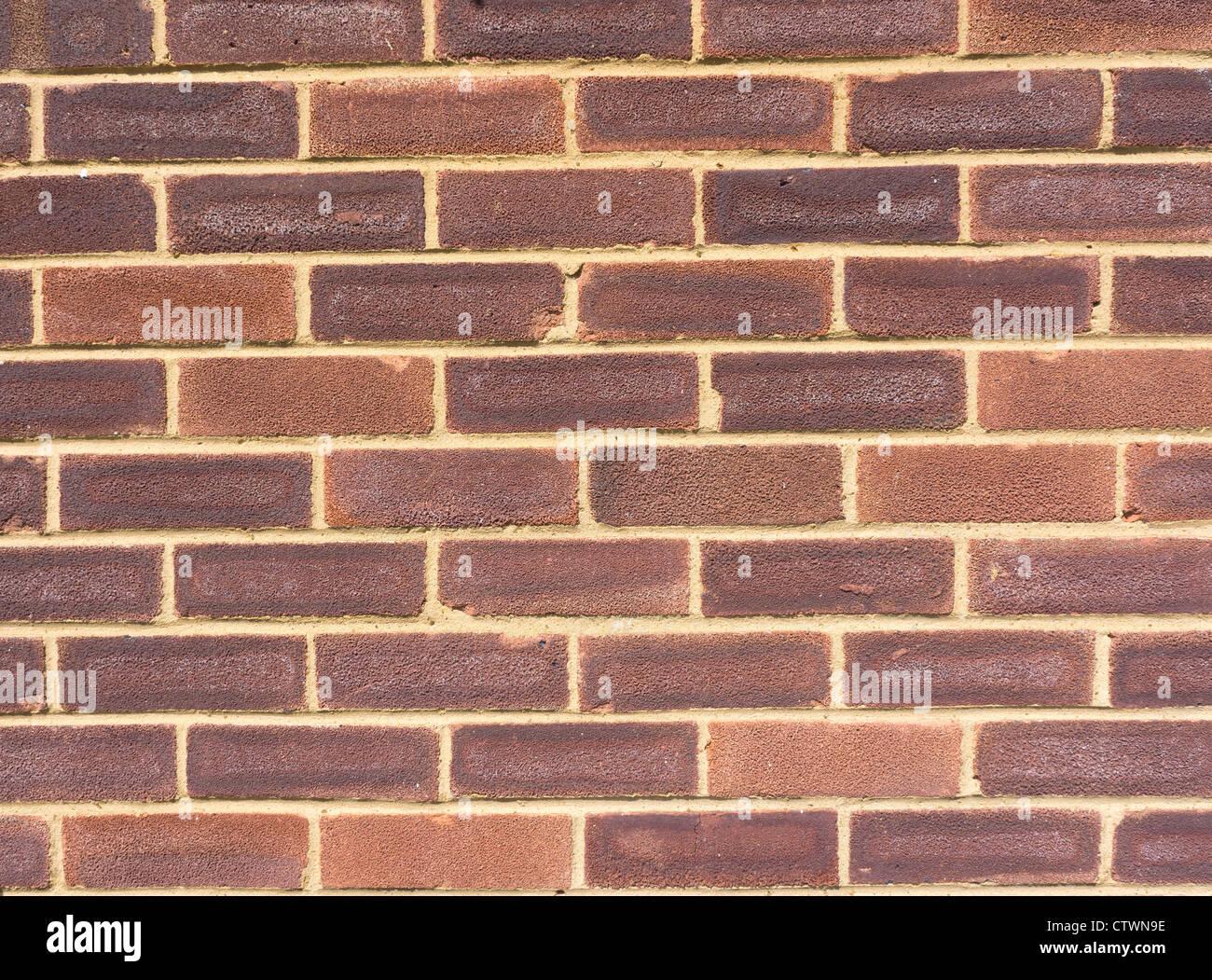 Schließen Sie auf einen Abschnitt einer gemauerten Wand Fassade Stockbild