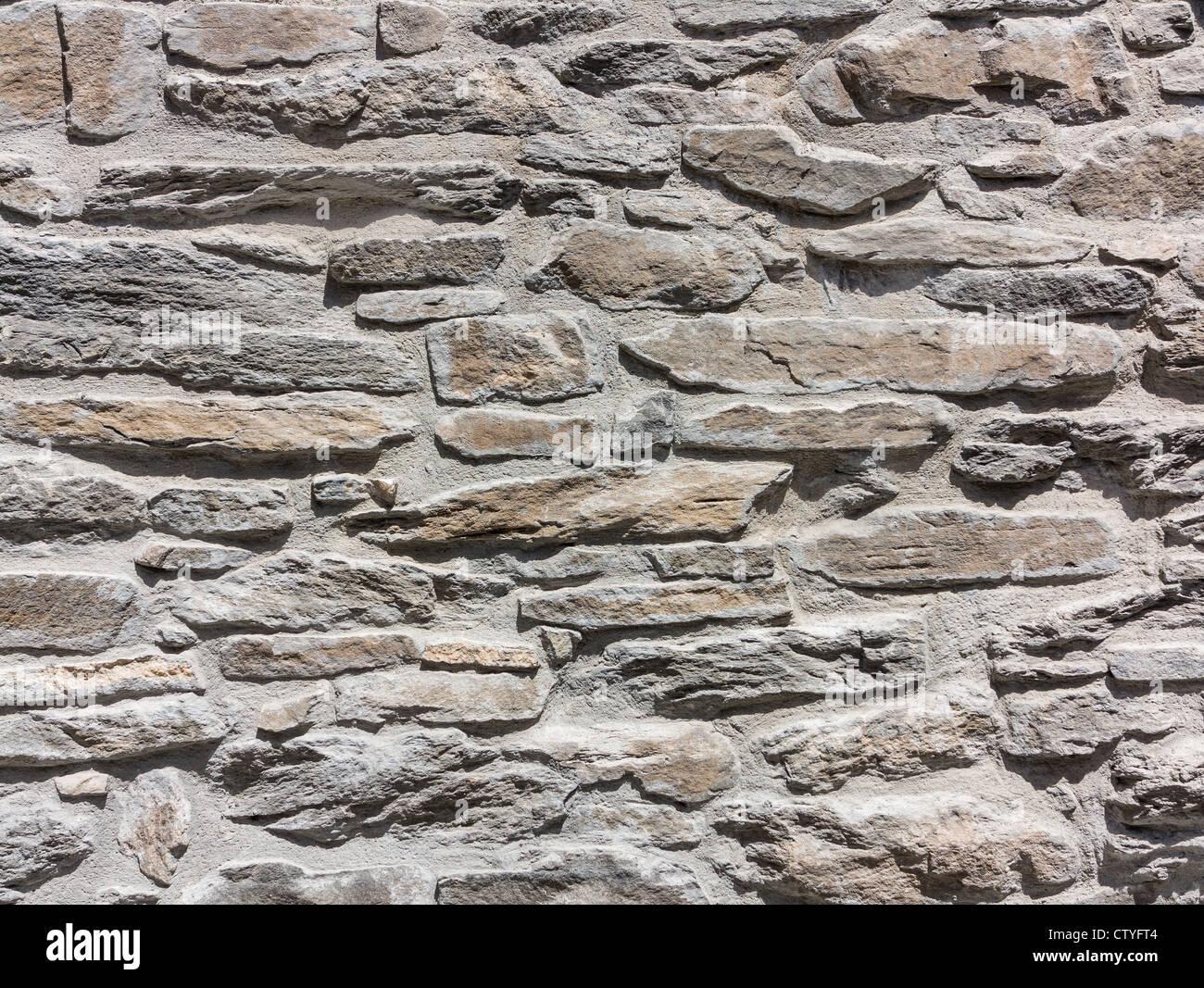 Ein Hintergrundbild von einer Steinmauer Stockbild