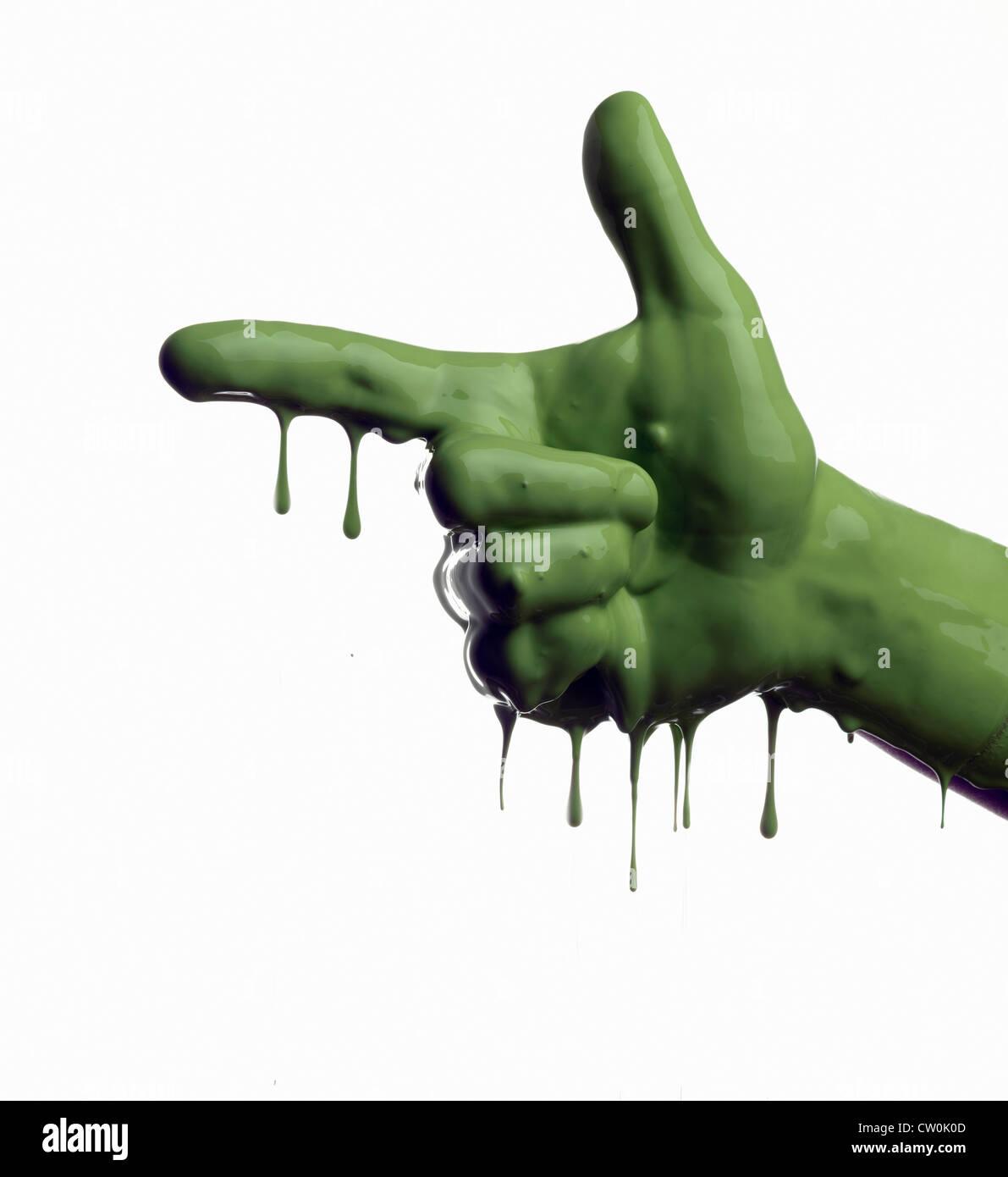 Grün lackiert Hand zeigen Stockbild