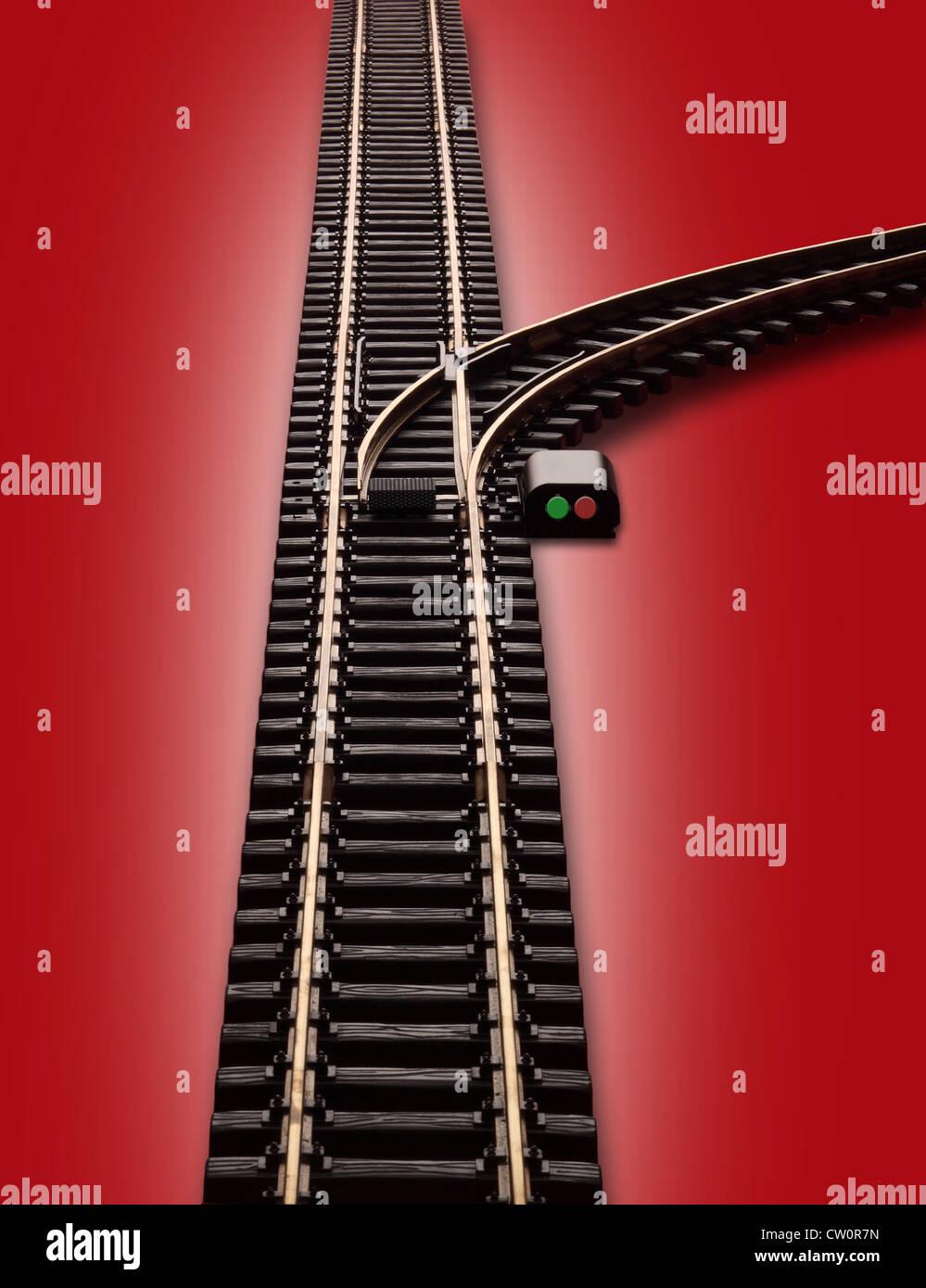 Modell Eisenbahn Bahnstrecke mit Schalter und ein Zweig der Spur nach rechts biegen. Schalter hat rote & grüne Stockbild