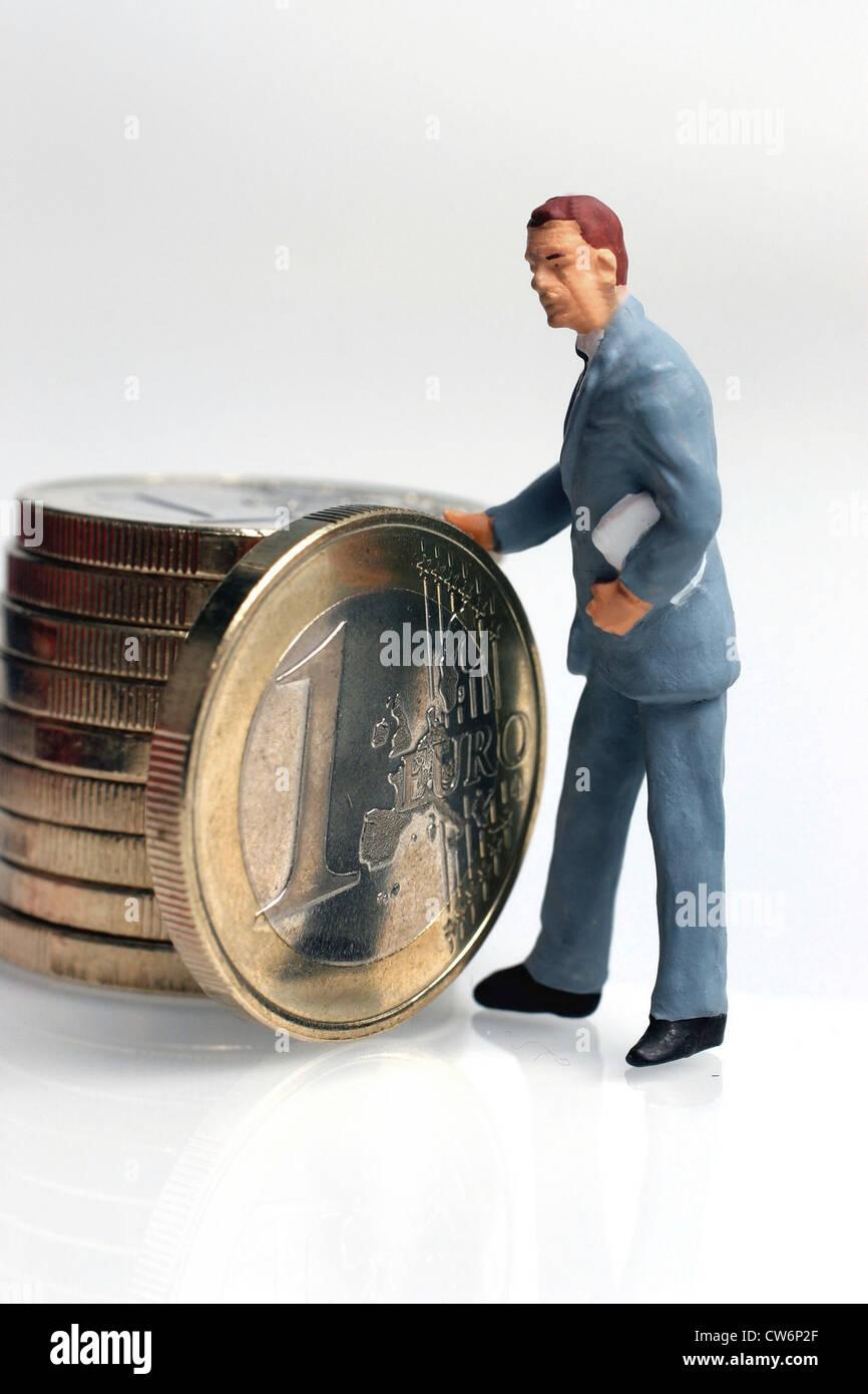 Figure With 1 Euro Coin Stockfotos Figure With 1 Euro Coin Bilder