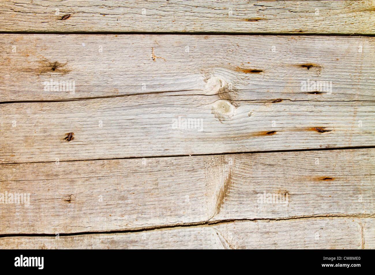 Alte verwitterte Holz Zaun Bretter mit Knoten Hautunreinheiten