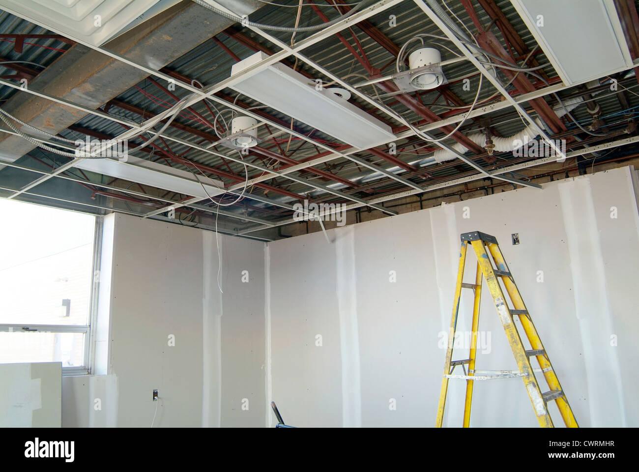 Leiter im Inneren der Baustelle Stockbild
