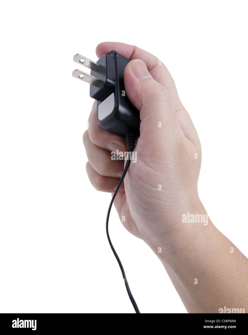 Hand, die eine Stromquelle die Steckdose anschließen. Stockbild