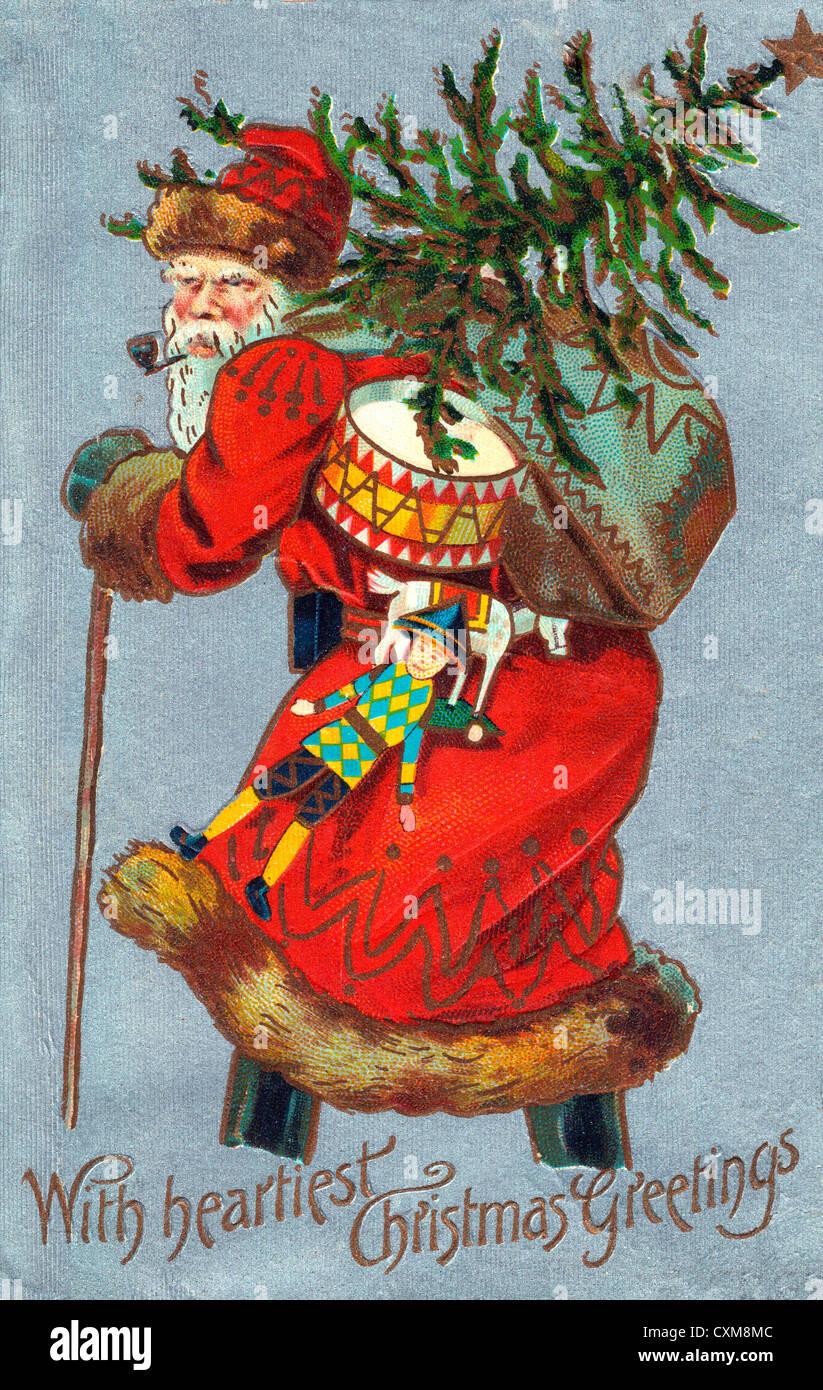 Mit herzlichsten Weihnachtsgrüße - Weihnachtsmann mit Baum und Geschenke Stockbild