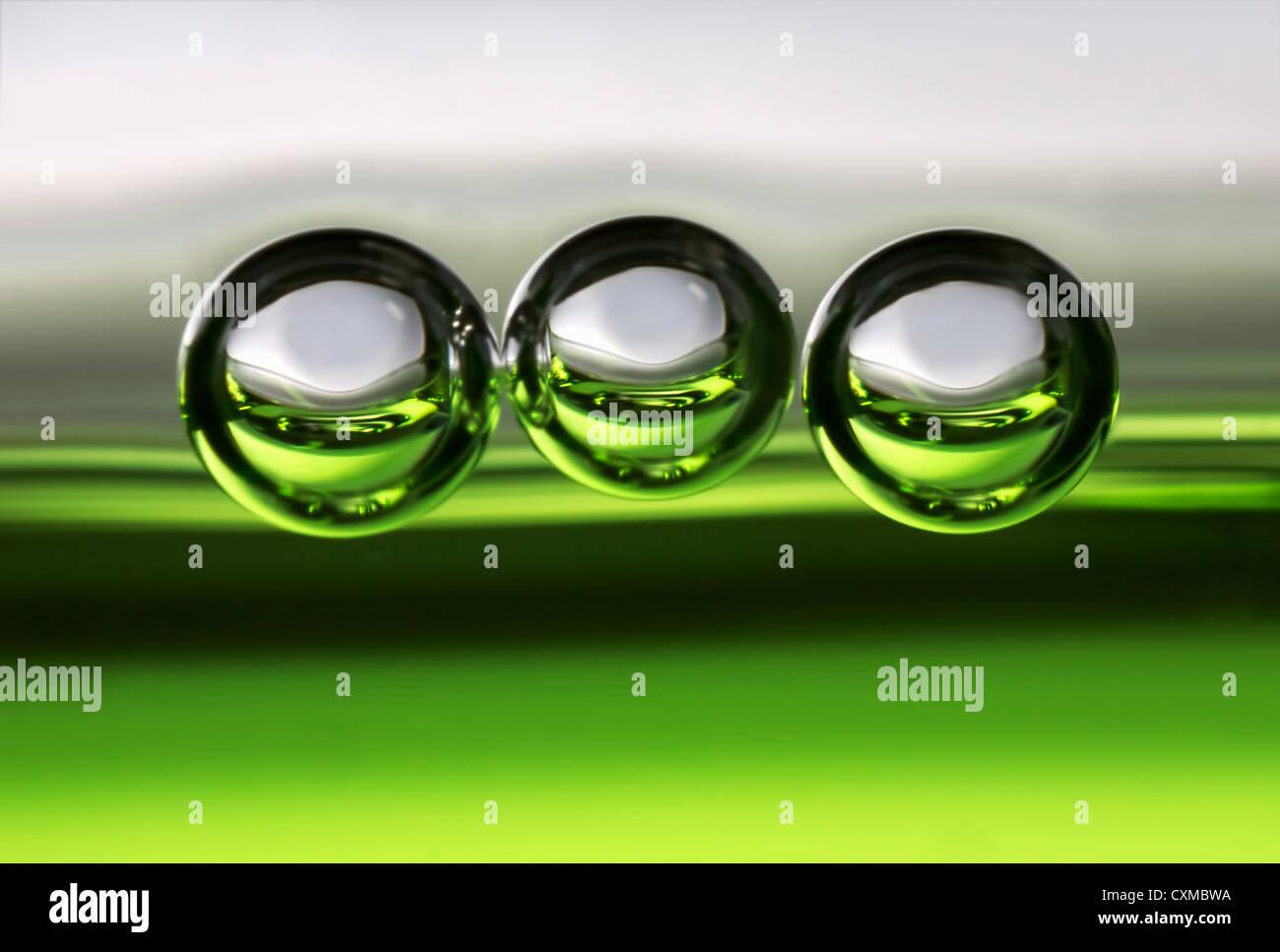 drei Luftblasen in einem Getränk Stockbild