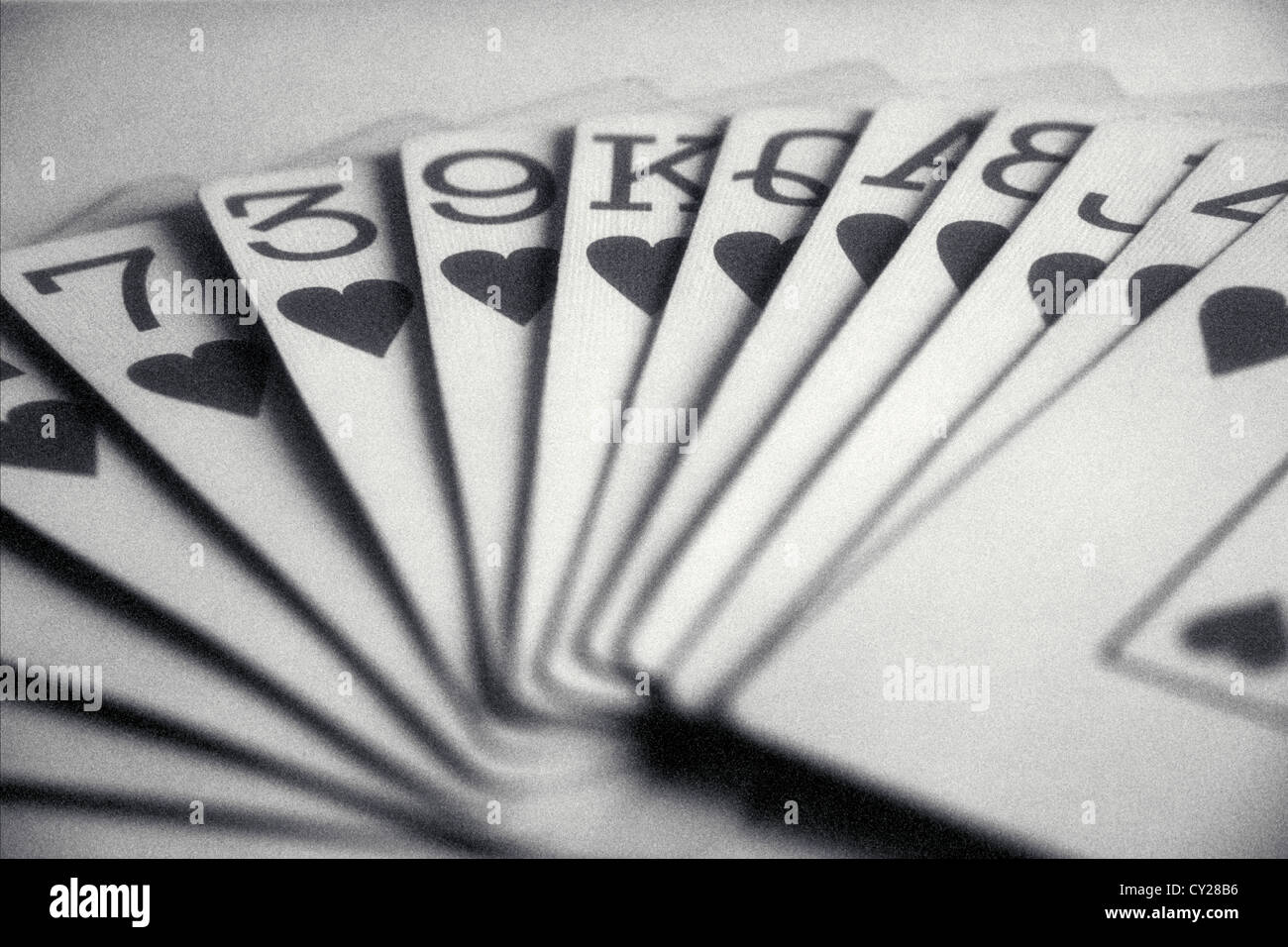 Hand von Spielkarten mit ganzen Herzen, © Mak Stockbild