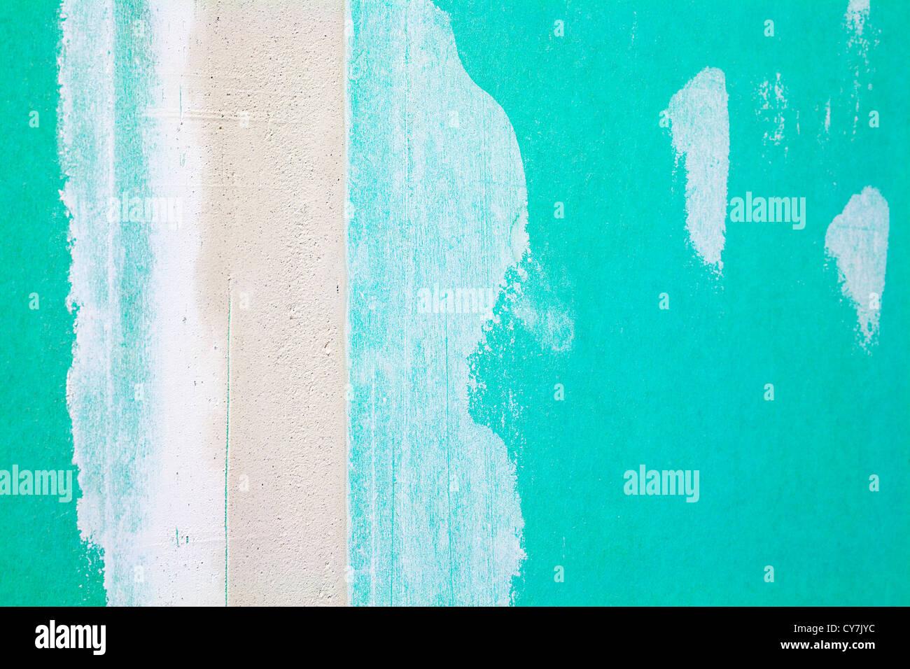 nahaufnahme von einer grünen gips rigipswand als architektur