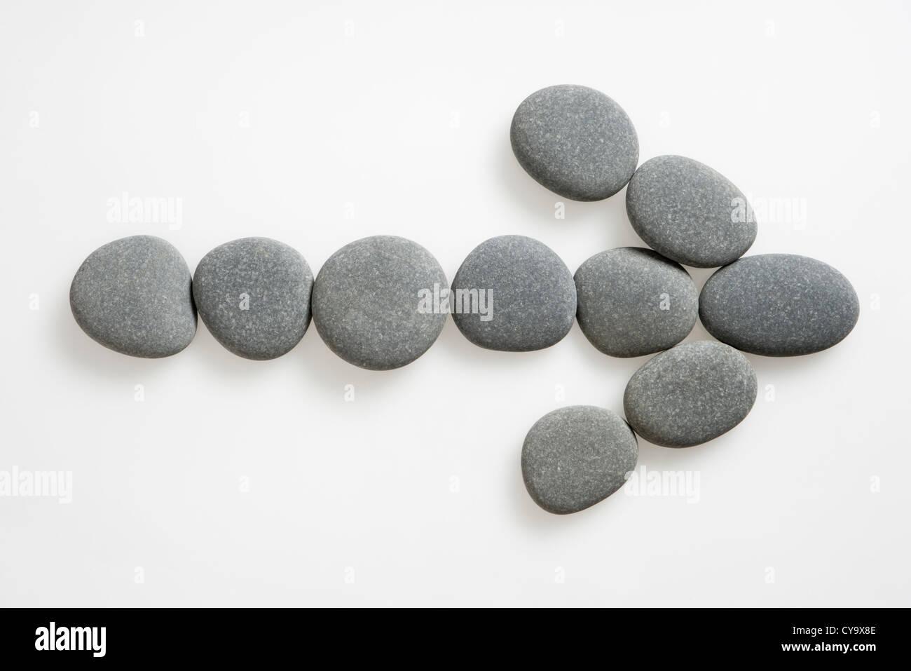 Pfeil von Steinen. Stockbild