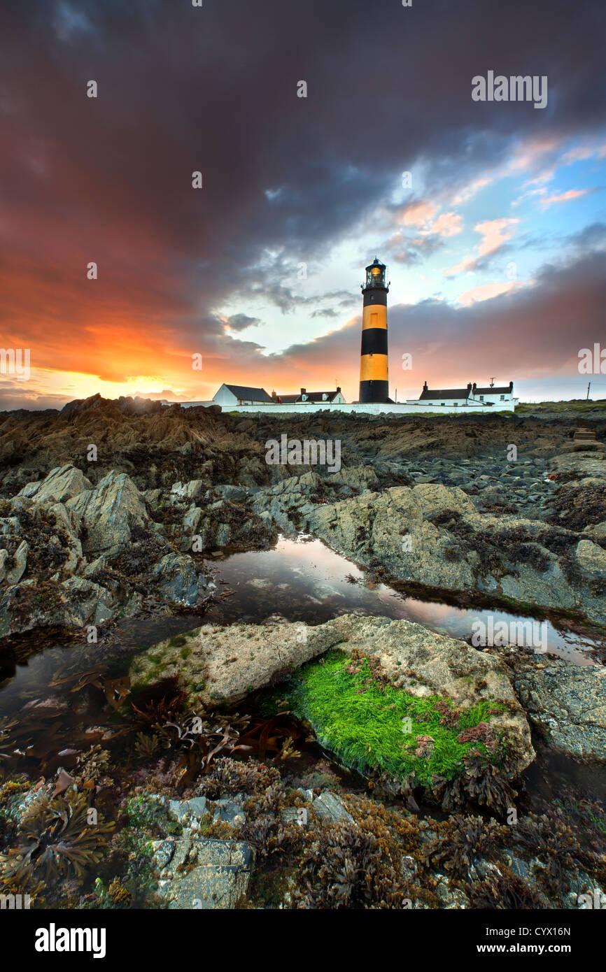 St Johns Leuchtturm im County Down bei Sonnenuntergang. Stockbild