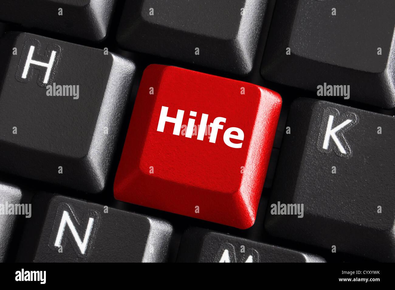 deutsches Wort Hilfe zeigt Hilfe oder Support-Konzept mit Tastatur Stockbild