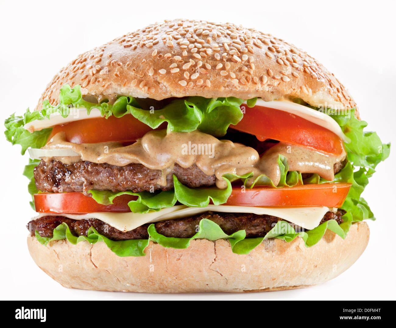 Leckere Hamburger auf weißem Hintergrund. Stockbild
