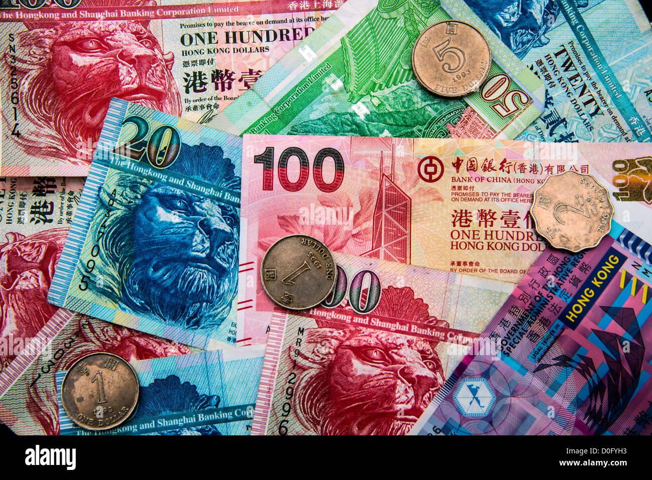 Hong Kong-Dollar-Banknoten und-Münzen Stockbild