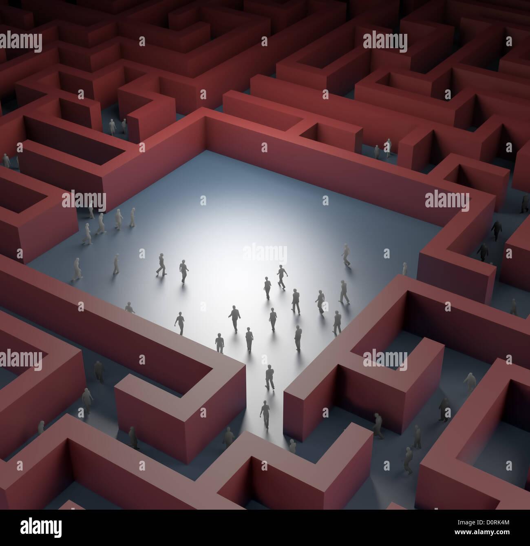 Kleine Menschen in einem Labyrinth Stockbild