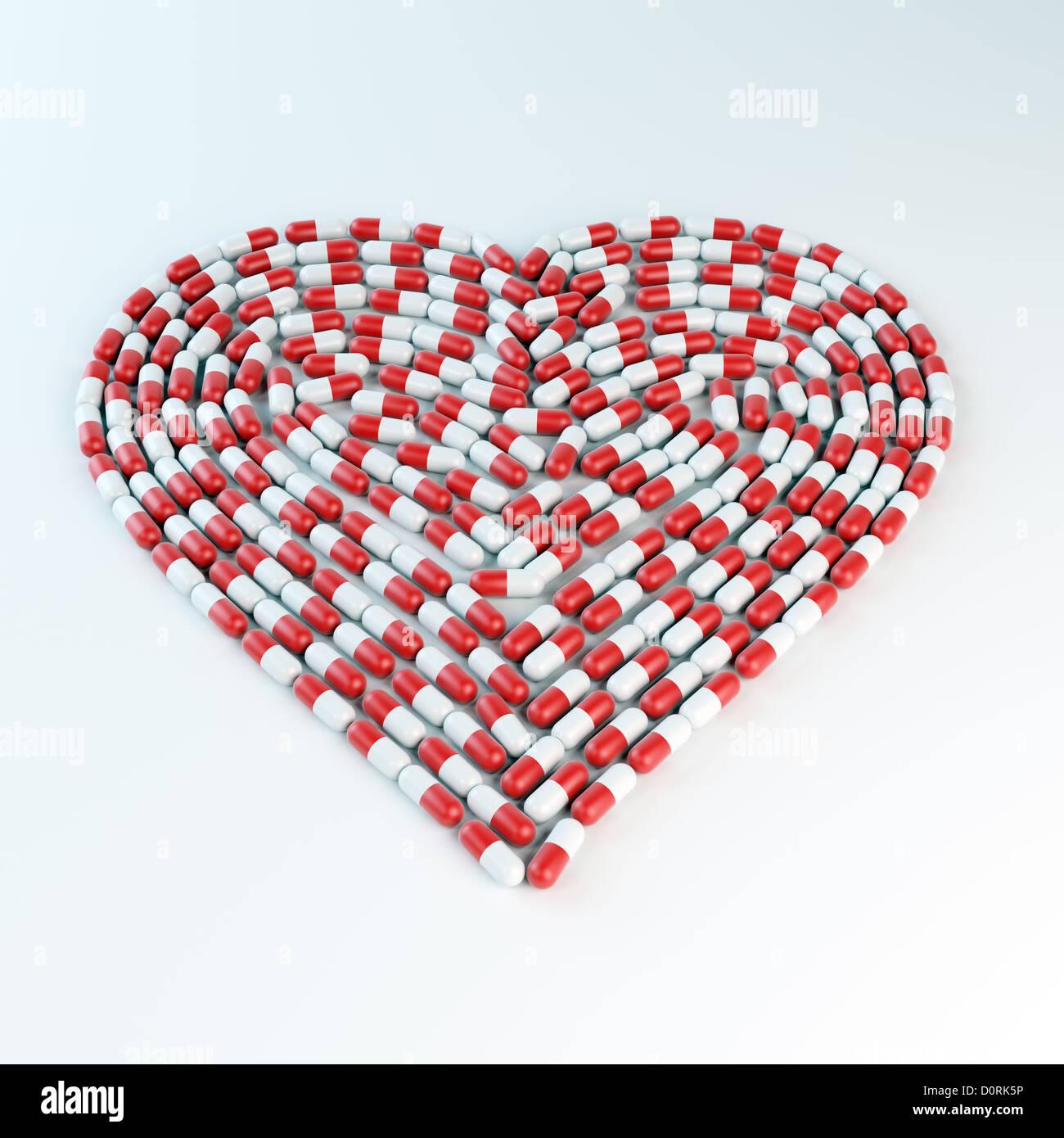 Rote und weiße Kapseln bilden ein Herz shap Stockbild
