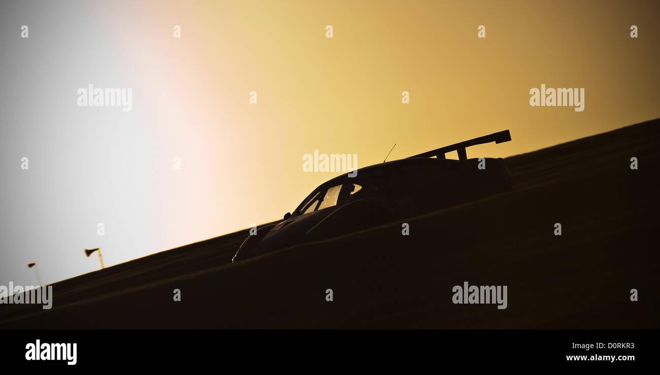 Der Ferrari 430 von Paul Bailey und Andy Schulz aufbrechen Craner Kurven wie die Sonne setzt. MSA Britcar Endurance Stockbild