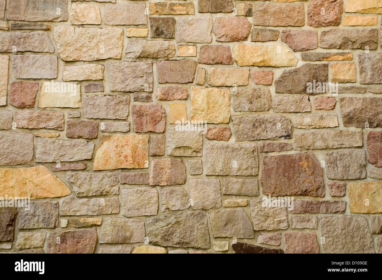 Ein Mauerwerk von bunten Steinen oder Blöcke Stockfoto