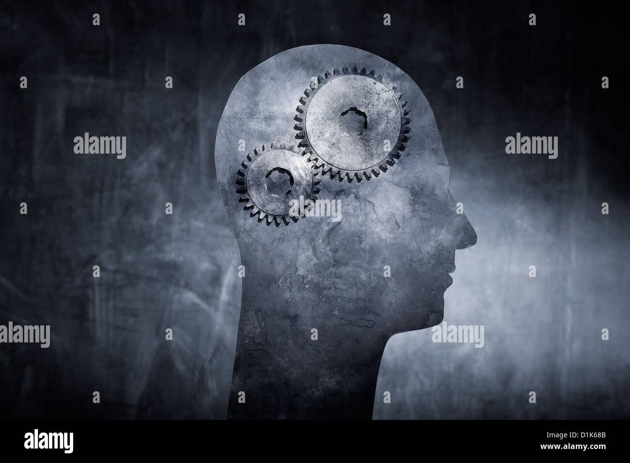 Konzeptbild eines Kopfes mit Zahnrad Zahnräder als Gehirn. Stockbild