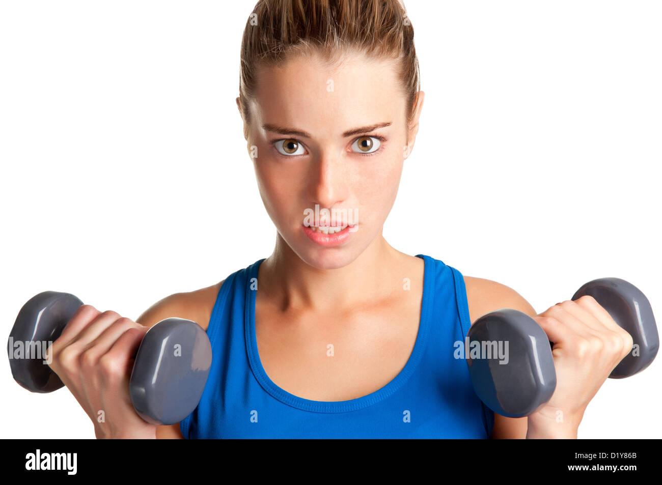 Frau mit Hanteln in einem Fitnessstudio trainieren Stockbild