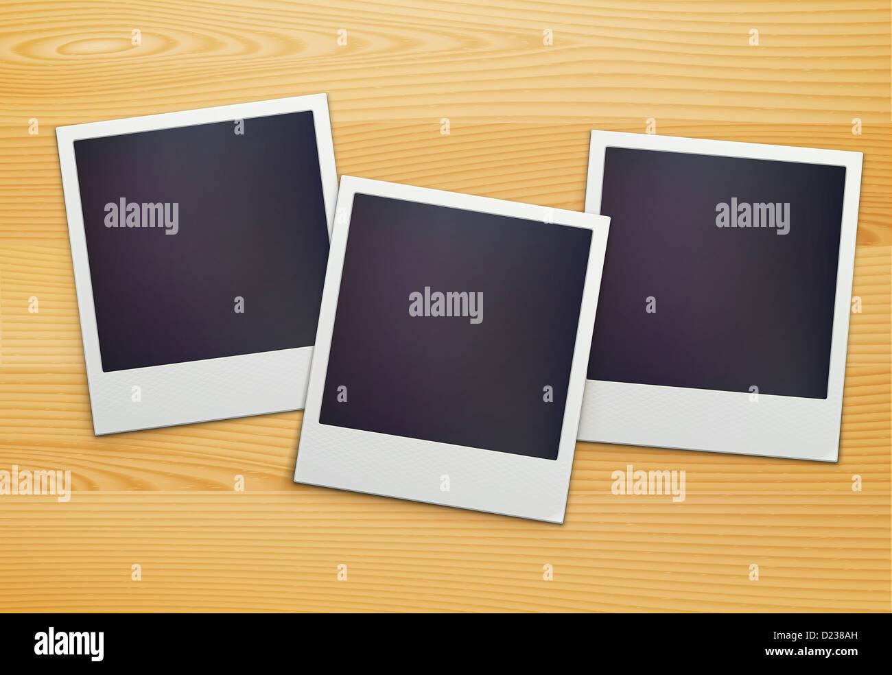 drei leere retro Polaroid Bilderrahmen über hölzerne Hintergrund ...