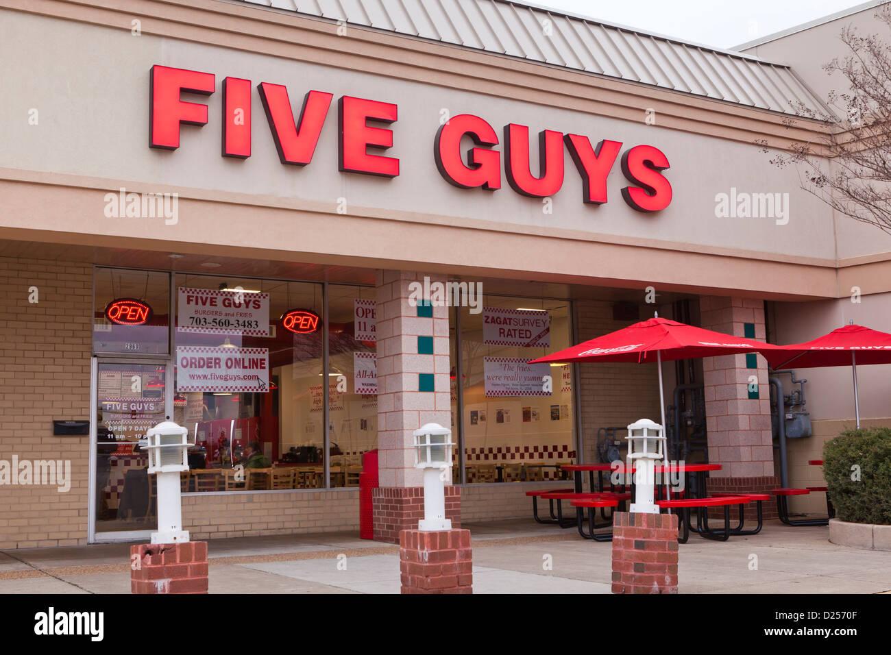Fünf Jungs Hamburger Schaufenster Stockbild
